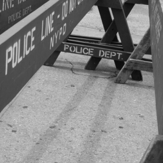 Black and white photograph of New York Police Department barriers taken by Alexandra Bogdanovic